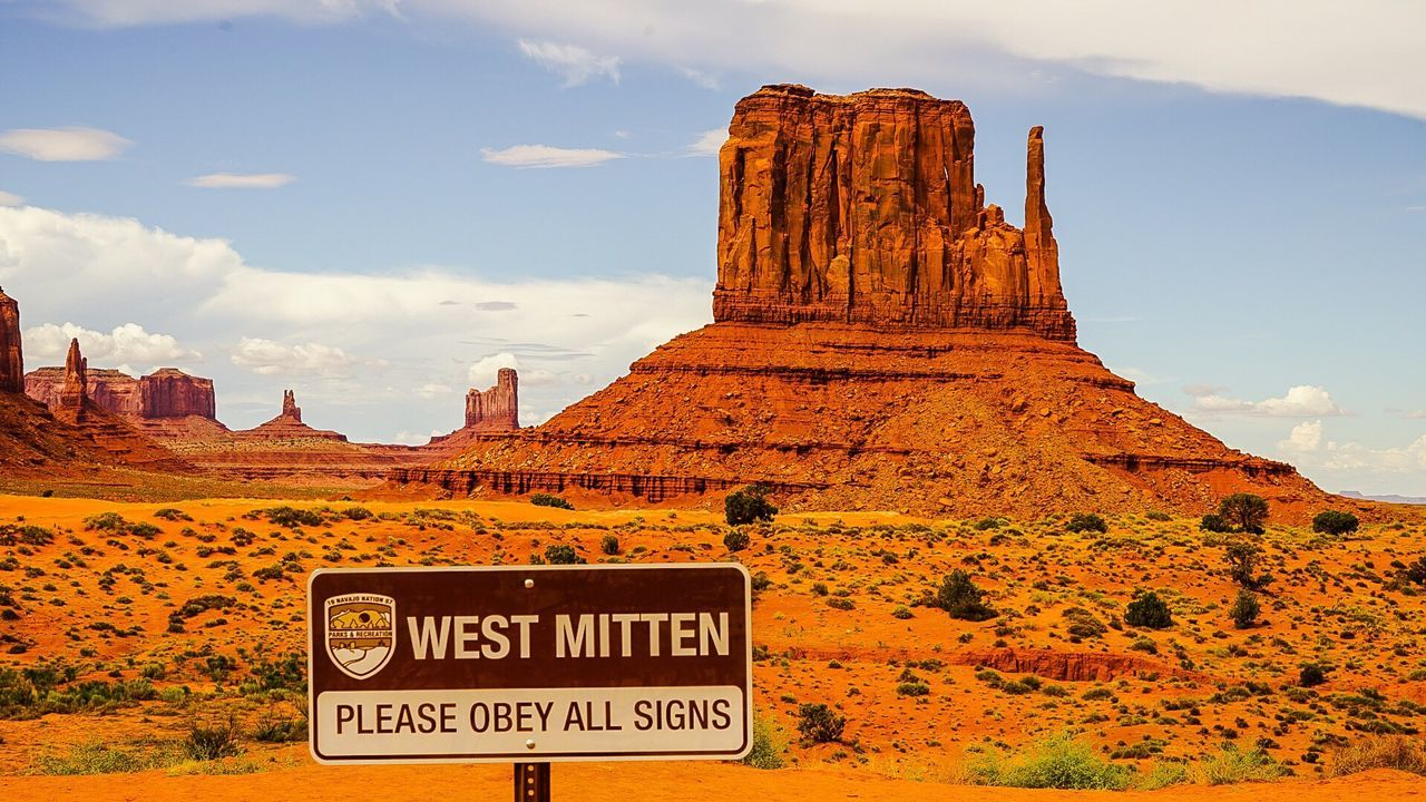 Sign Against West Mitten At Monument Valley