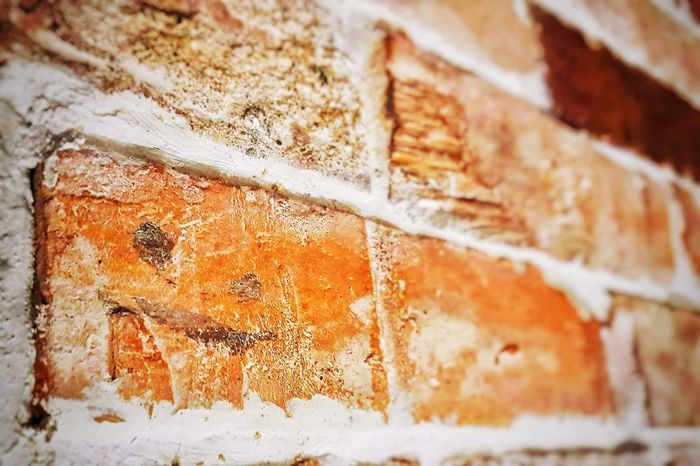 EyeEmNewHere Backgrounds Rusty Close-up Textured  Full Frame Rough No People Day Outdoors Architecture Smile Brick Wall Bricks Old Buildings Red Mix Yourself A Good Time