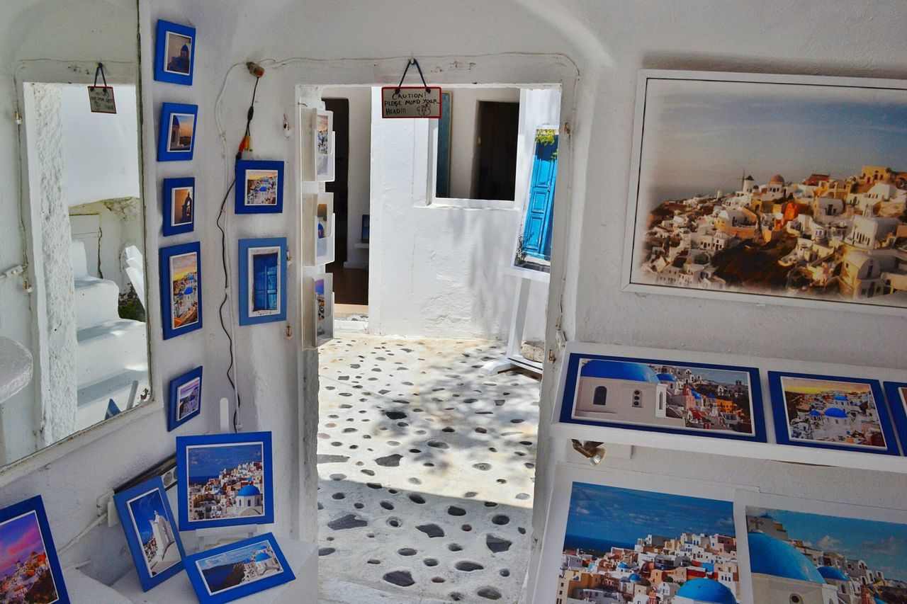 Walls full of art Santorini Santorini Island Cyclades Grecia Greece Indoors  House Architecture Collection White Blue Walls Door Shop Exposition Paintings Pictures Art Arte QUADRI Negozio Esposizione Interior My Favorite Place My Year My View Finding New Frontiers Art Is Everywhere The Secret Spaces