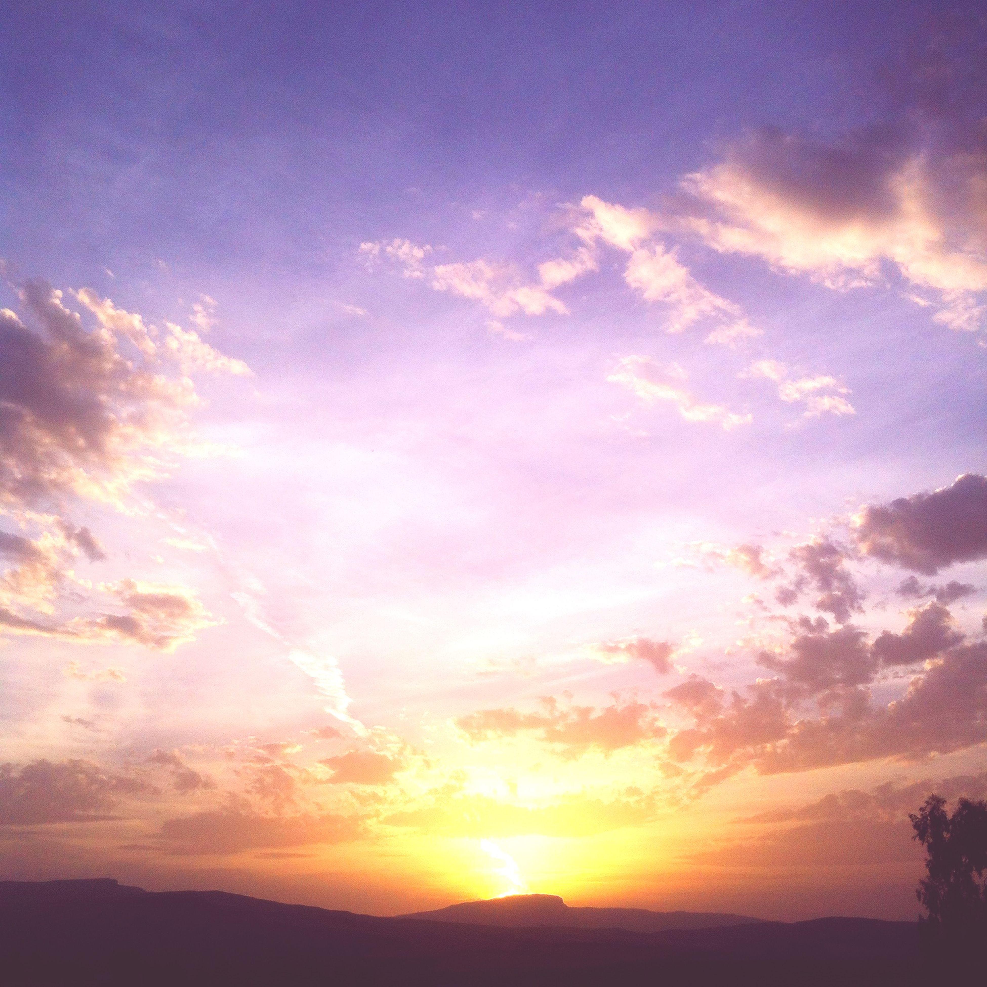 sunset, sun, sky, tranquil scene, scenics, beauty in nature, tranquility, silhouette, cloud - sky, sunbeam, sunlight, nature, landscape, idyllic, orange color, cloud, lens flare, outdoors, no people, field