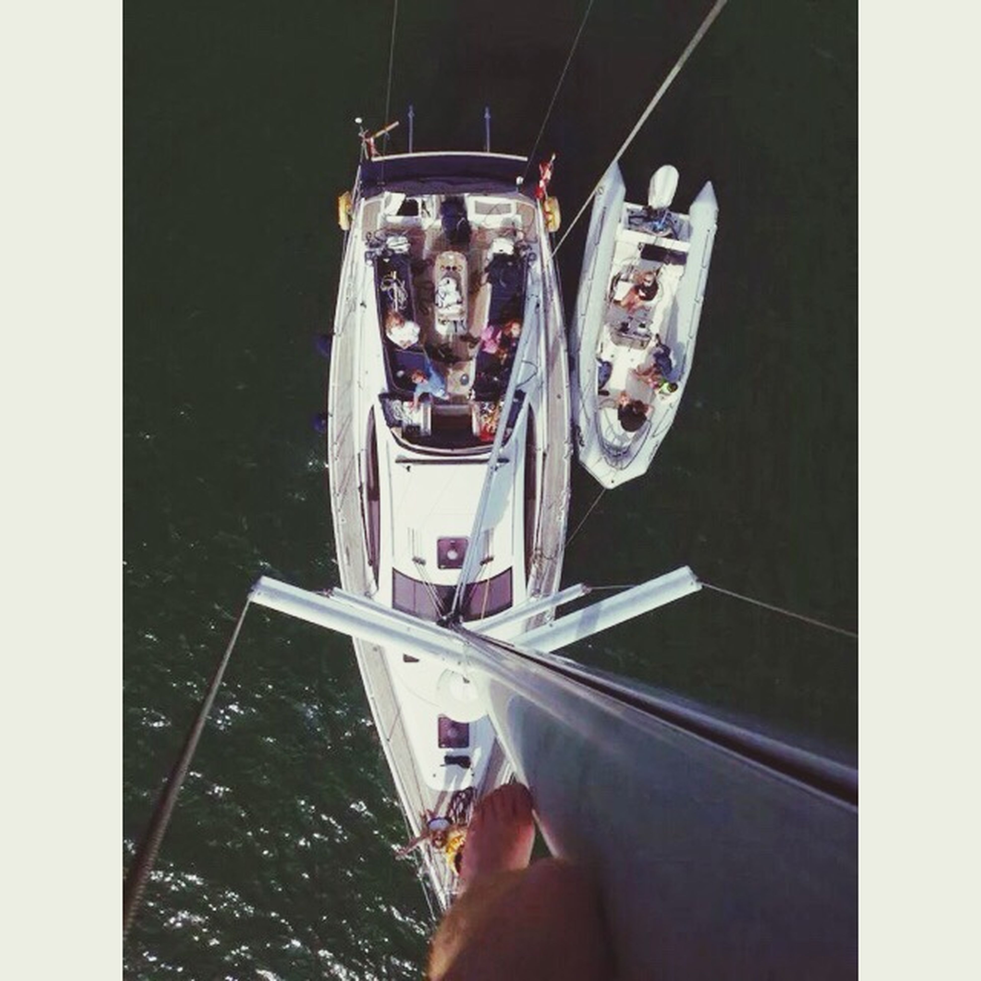 lifestyles, holding, transfer print, leisure activity, auto post production filter, photography themes, transportation, men, wireless technology, technology, sitting, photographing, smart phone, person, nautical vessel, indoors, part of, mode of transport
