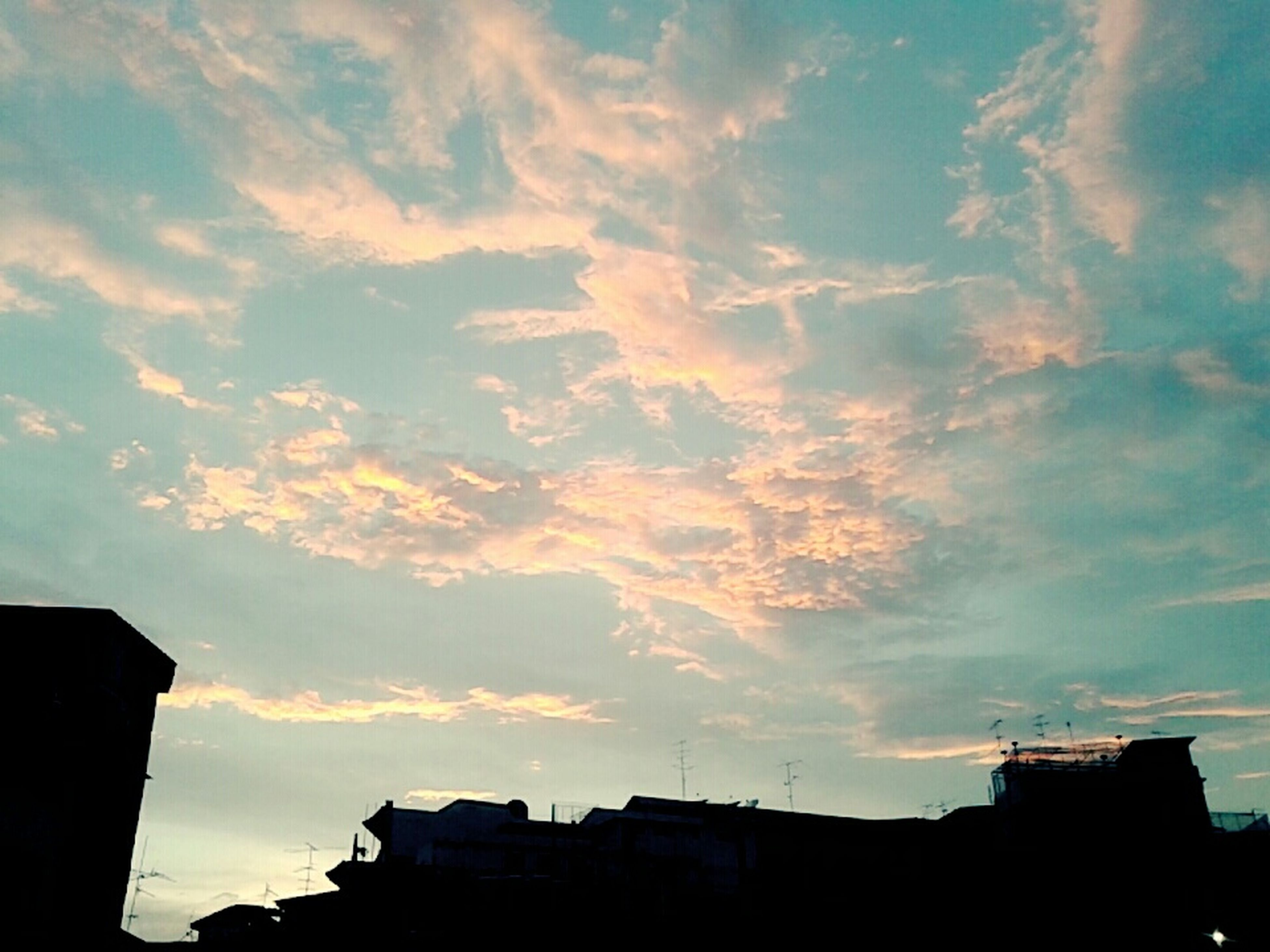 building exterior, architecture, built structure, sky, silhouette, low angle view, sunset, cloud - sky, house, residential structure, building, cloud, cloudy, residential building, high section, city, outdoors, nature, dusk, beauty in nature