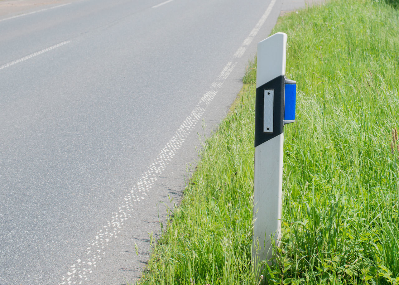 Guiding post with blue wild reflector on the road Accident Accident Damage Animals Blue Reflector Danger Demarcation Highway Main Road Nature Night Protection Road Road Marking Road Sign Roadway Safety Traffic Twilight Wild Wild Accident Wild Animal Wild Change Wild Reflector