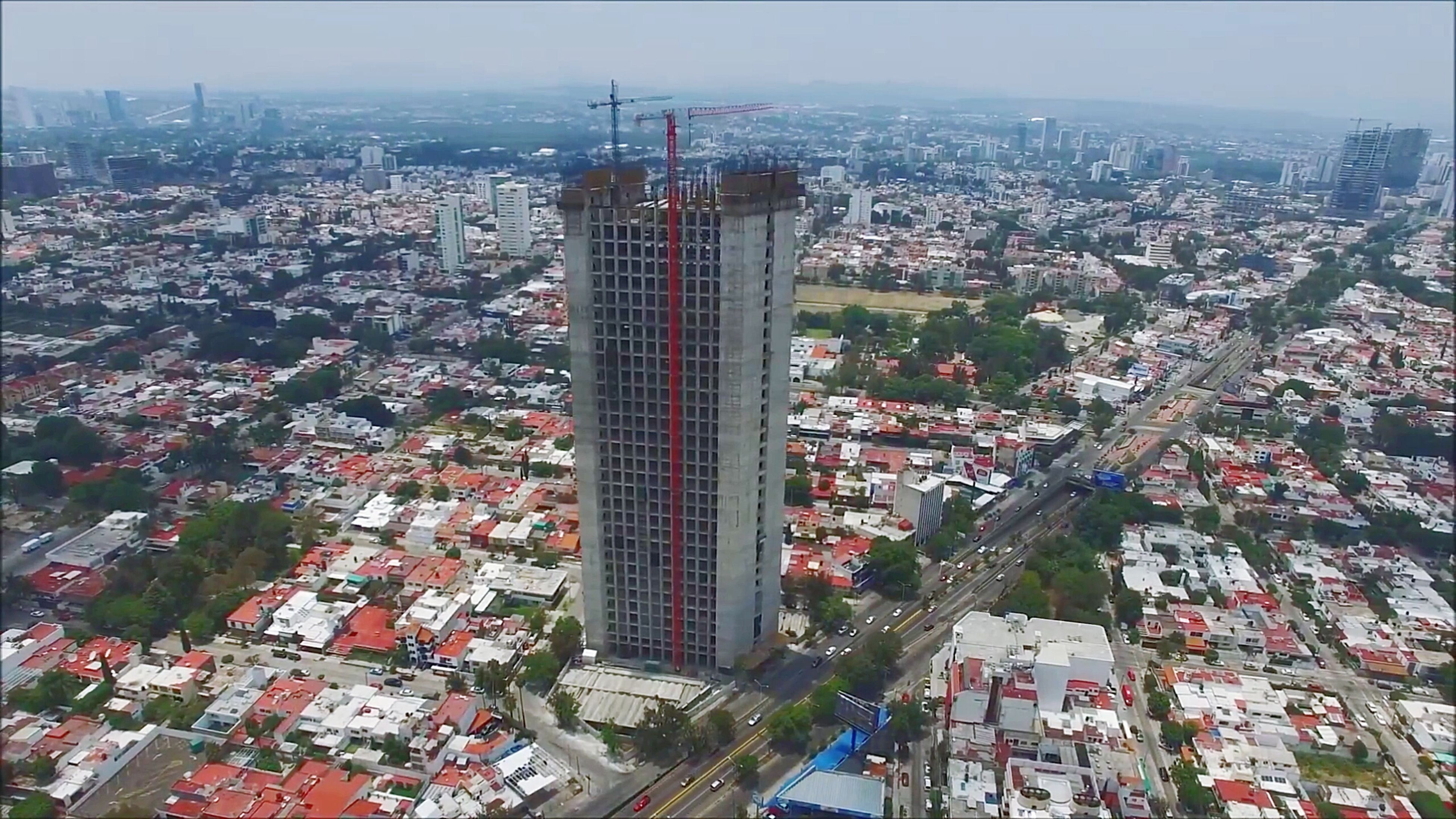 city, cityscape, architecture, building exterior, skyscraper, modern, no people, aerial view, outdoors, sky, day, tree, residential