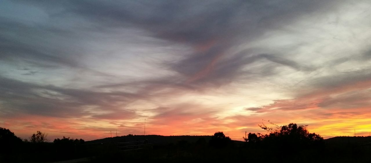 sunset, silhouette, beauty in nature, dramatic sky, scenics, cloud - sky, sky, tranquil scene, nature, tree, tranquility, orange color, no people, landscape, outdoors