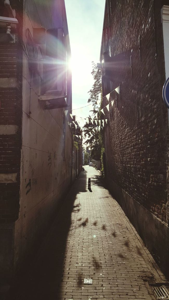 Architecture Building Exterior Built Structure The Way Forward Sunlight Footpath Diminishing Perspective Cobblestone Shadow Sunbeam Day Sky Sunny Narrow Outdoors Alley Vanishing Point Sun Lens Flare Alleyway Dutch Architecture Town Taking Pictures Taking Photos Cozy