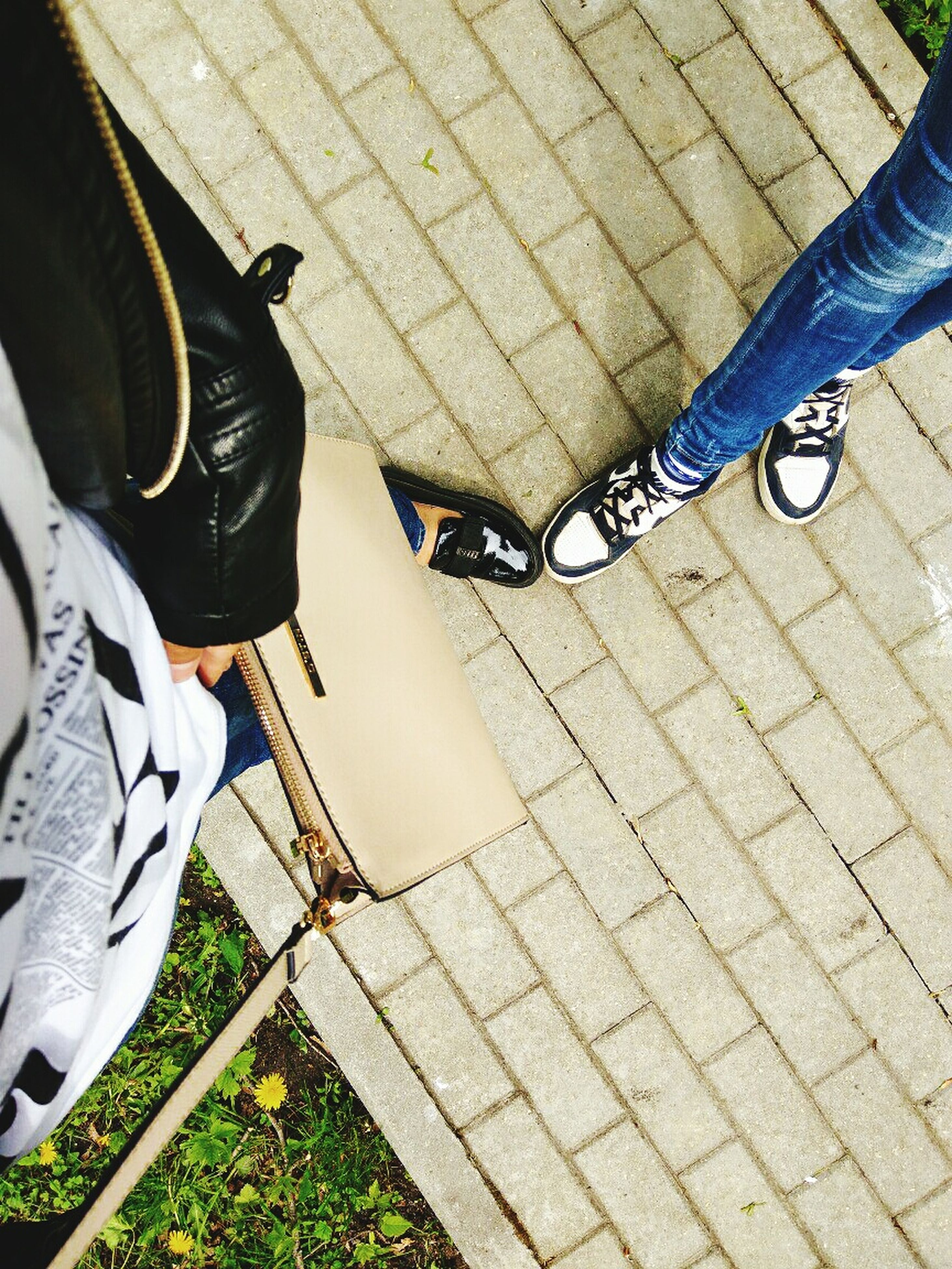 low section, shoe, human leg, standing, high angle view, real people, jeans, human body part, casual clothing, day, outdoors, men, lifestyles, directly above, human hand, close-up, people