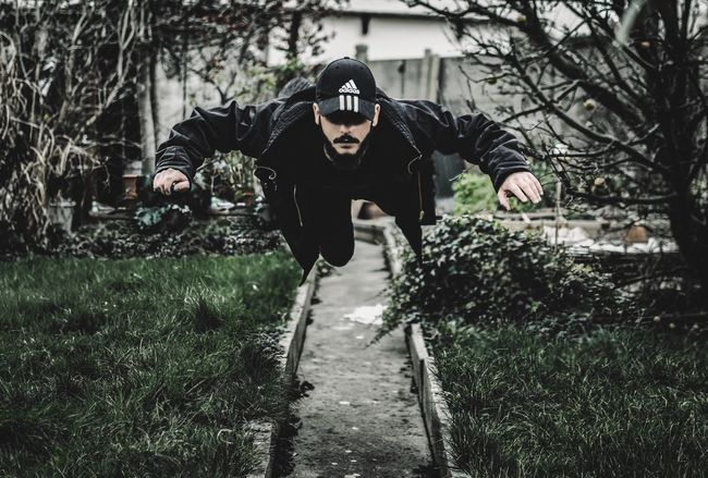 Never lost your inner child Nature Lifestyles Growth Young Adult Green Flying Peter Pan Levitation Welevitate Style Fashion Dark Black Clothes Adidas Taking Photos Garden Outdoors Capture The Moment Freedom Flying High Fly