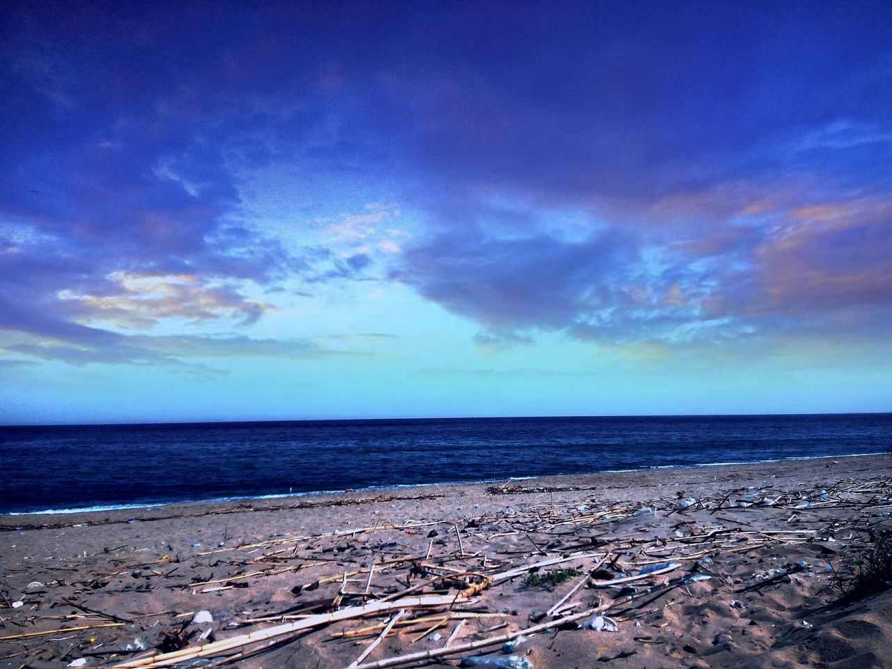 sea, horizon over water, sky, scenics, water, tranquil scene, tranquility, nature, cloud - sky, beauty in nature, beach, outdoors, blue, no people, day