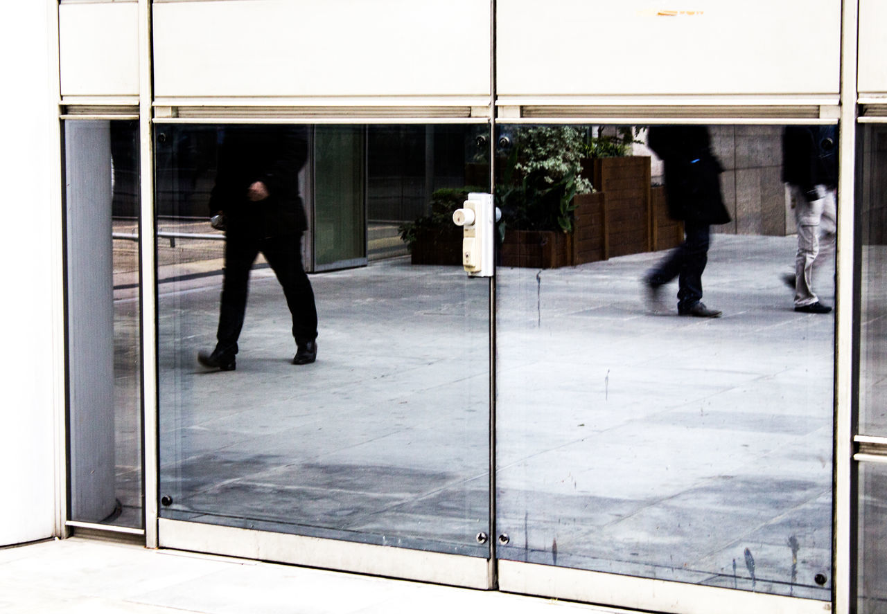 The mirror of walk Adult Adults Only Architecture Architecture_collection Black Buiding Business City City Life Entrance Full Length Grey Legs Lifestyles Men Mirror Modern Only Men People Real People Sliding Door Urban Urban Exploration White The Street Photographer - 2017 EyeEm Awards