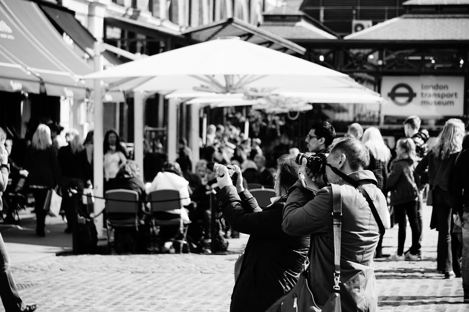 1848 Black & White Black And White Black And White Photography Black&white Blackandwhite Blackandwhite Photography Blackandwhitephotography Cameras City City City Life Day Focus On Foreground Large Group Of People Lifestyles Men Outdoors People Photographers Real People Walking Women