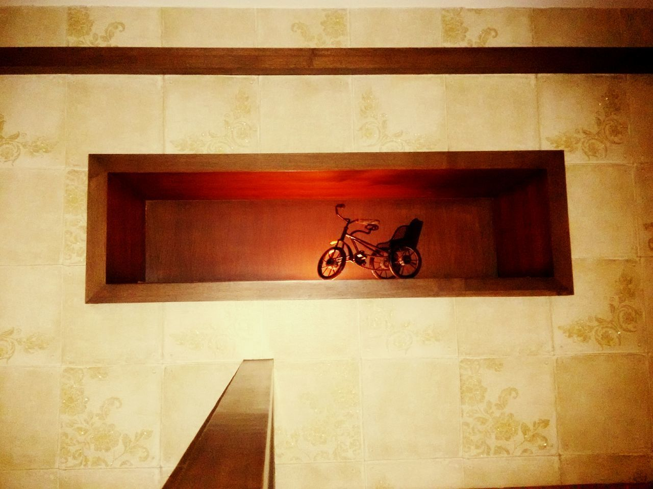 Toy Bicycle In Cabinet On Wall At Home