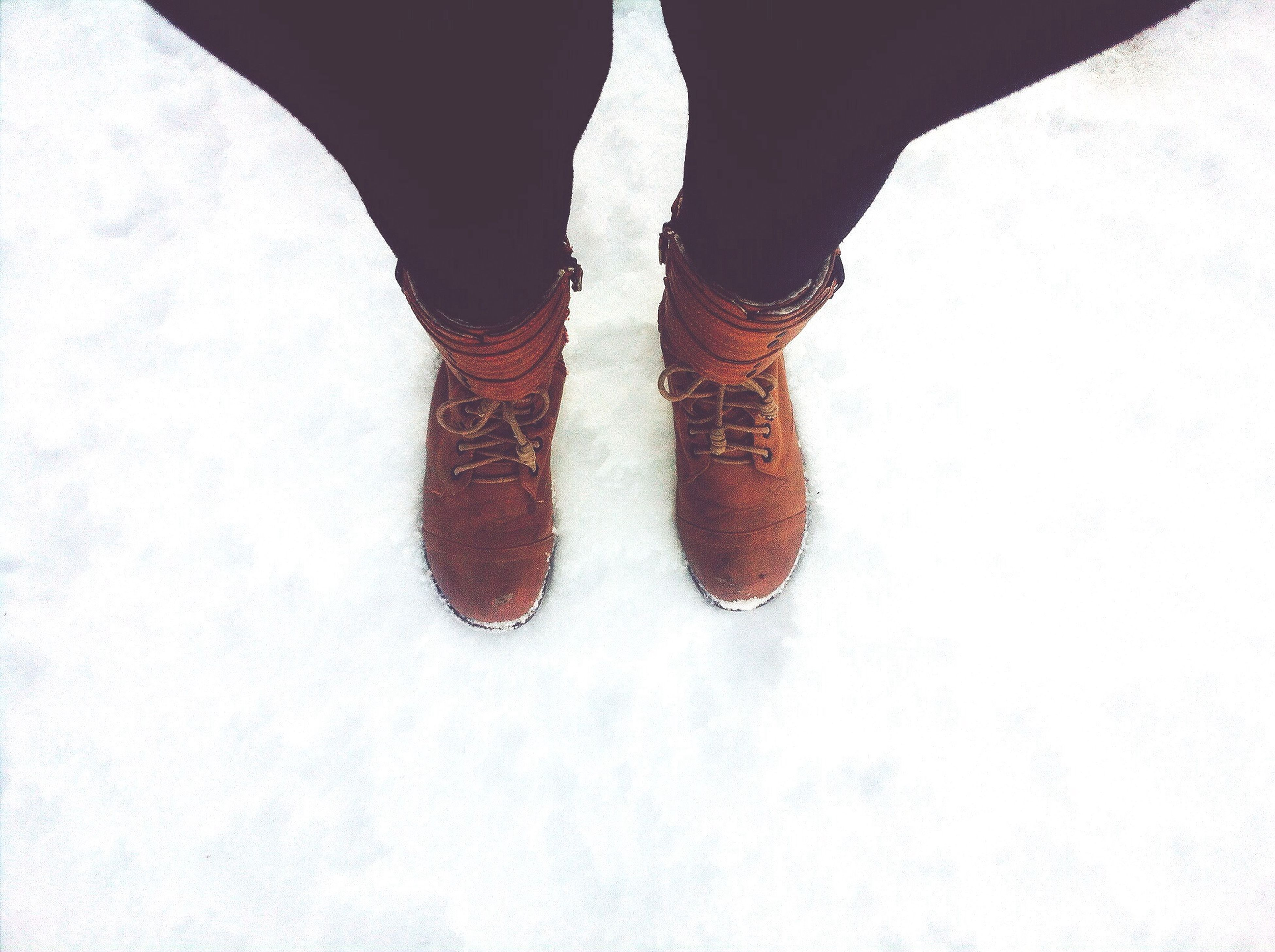 low section, person, shoe, winter, snow, cold temperature, human foot, standing, season, footwear, unrecognizable person, lifestyles, part of, high angle view, jeans, men, personal perspective