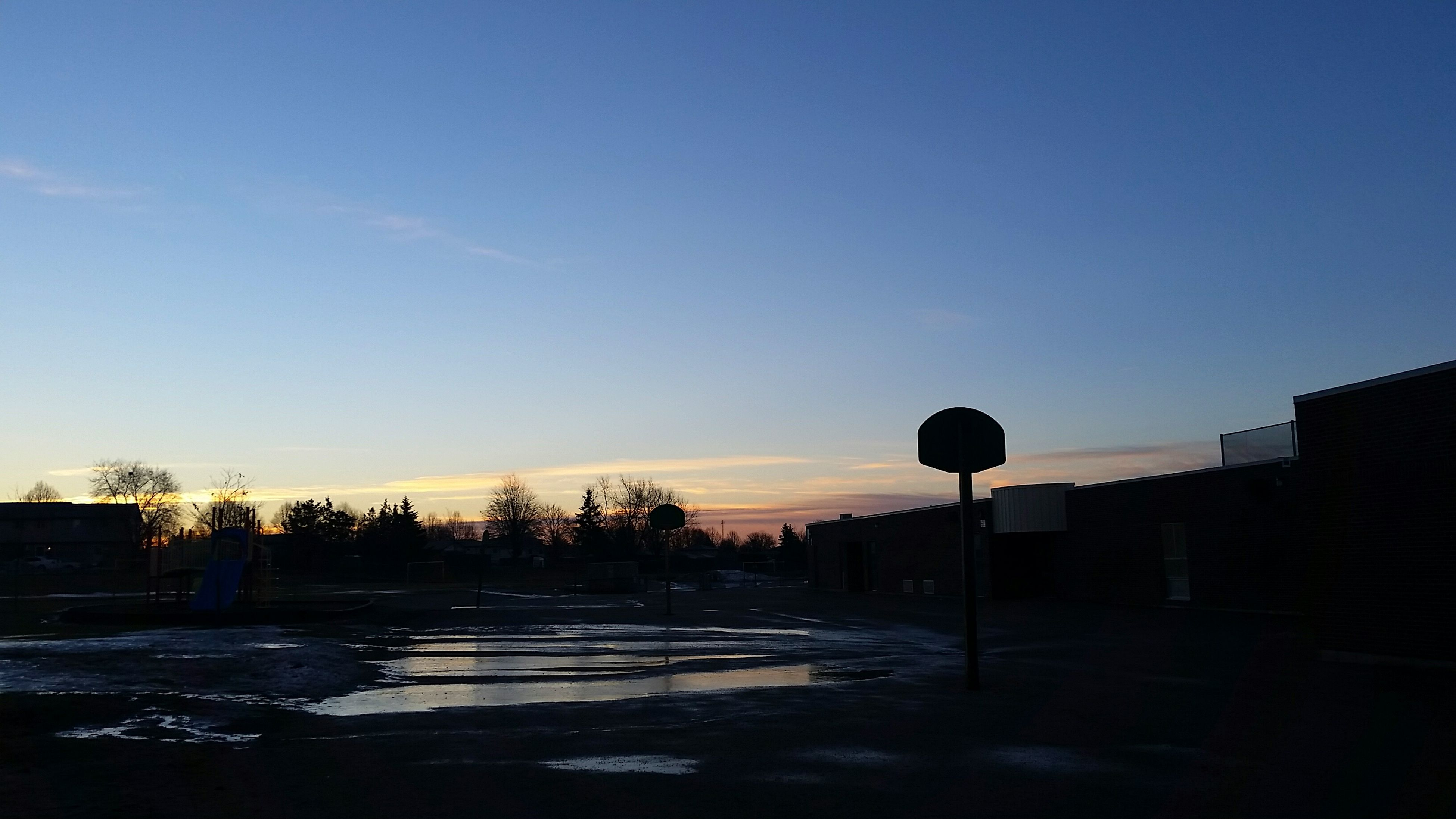 clear sky, copy space, sunset, blue, building exterior, built structure, sky, silhouette, architecture, tree, street light, tranquility, tranquil scene, outdoors, road, dusk, nature, scenics, no people, beauty in nature