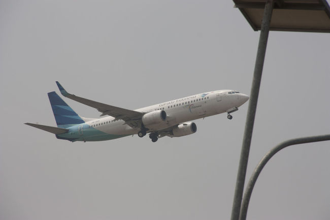 Garuda Indonesia airlines Blue Day Flying Garuda Indonesia .. Low Angle View Mid-air Mode Of Transport Nature No People Outdoors Sky