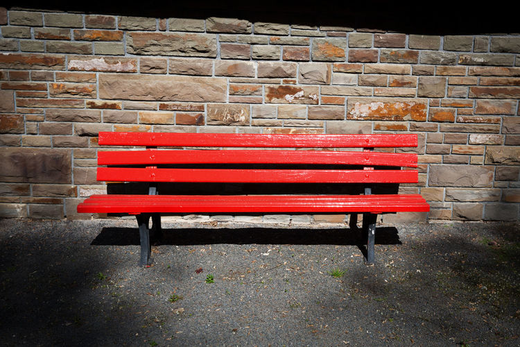 1 Absence Bench Day Empty No People Outdoors Red Seat Seat Bench Sitting Stone Wall Sunlight And Shadow Wall