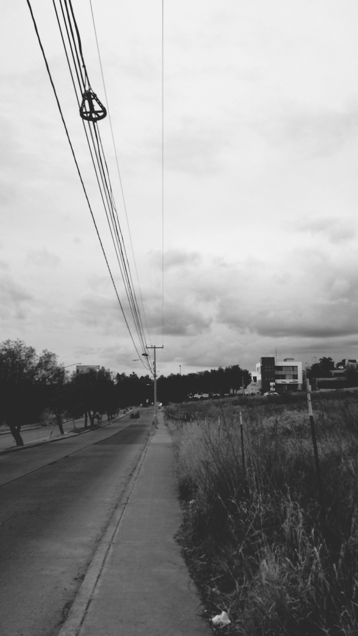 power line, electricity pylon, electricity, cable, power supply, transportation, connection, sky, the way forward, fuel and power generation, power cable, diminishing perspective, technology, cloud - sky, tree, railroad track, road, vanishing point, day, rail transportation