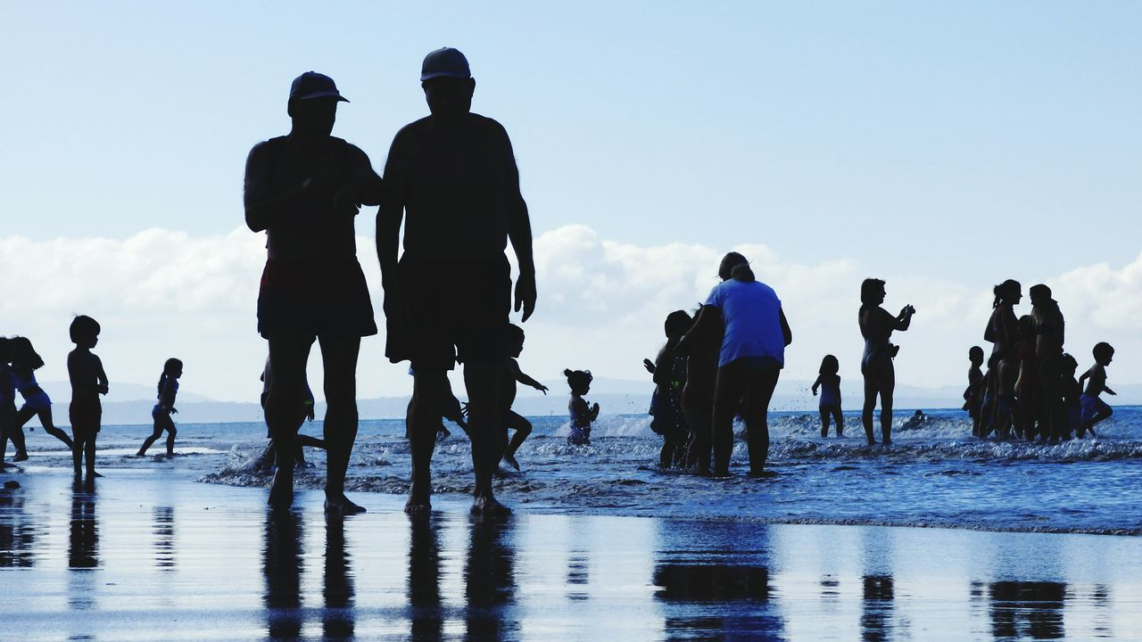 Water Walking People Silhouette Sea Day Outdoors Togetherness Adult Sky Nature Children Playing On Beach Human Silhouettes Beach Photography Beach Life Vacation Time Vacation 2017 Blue Wave