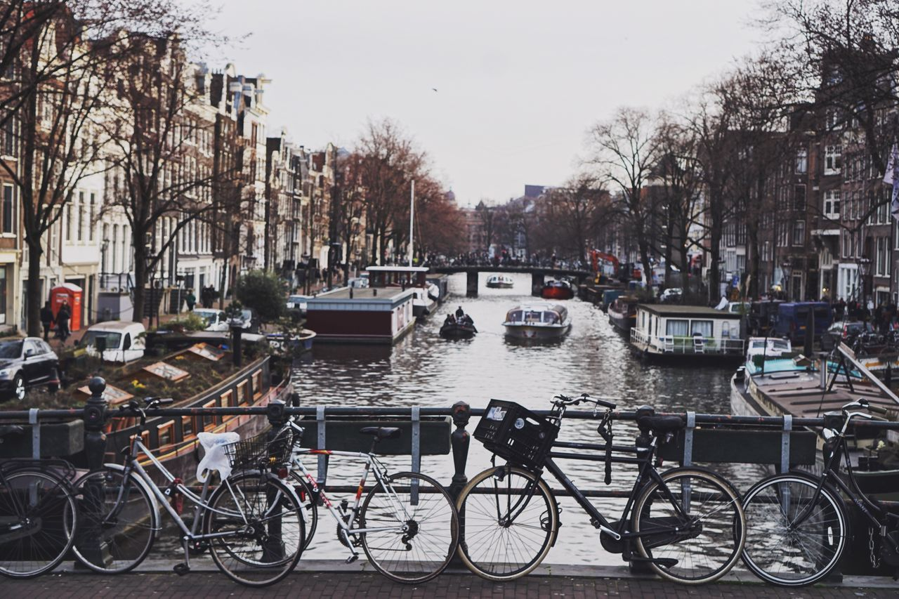 Transportation Mode Of Transport Land Vehicle Bicycle Stationary Building Exterior Canal City Built Structure Water Architecture Outdoors Parking Day City Life No People Sky Real Photography Amsterdam Cityscape Lifestyles City Architecture Travel Destinations Travel