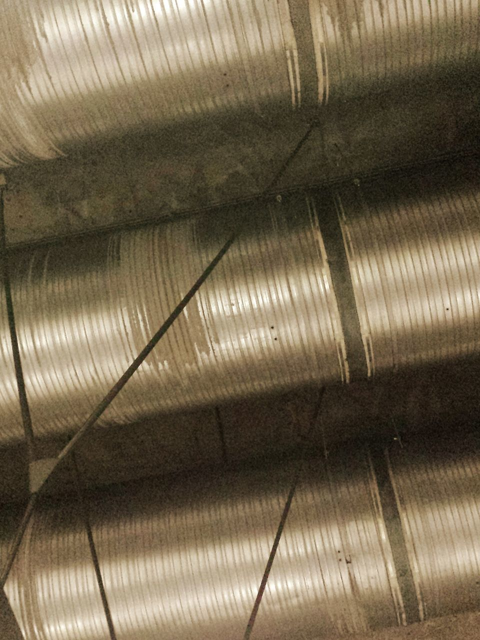 metal, silver colored, spool, textile industry, industry, machinery, indoors, manufacturing equipment, factory, silver - metal, steel, technology, no people, close-up, aluminum, day