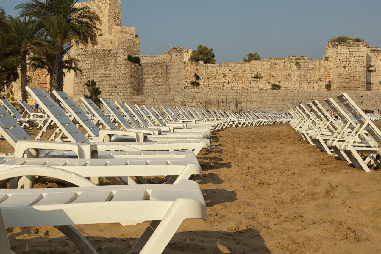 Mediterranean Sea Ancient Ancient Civilization Architecture Beach Beach Chairs Beauty In Nature Built Structure Day History Mediterranean  Mediterranean Sea Mersin Turkey Nature Old Ruin Outdoors Seat Shorelines Sunlight Tourism Tranquil Scene Tranquility Travel Destinations Turkey Water Waterfrontview