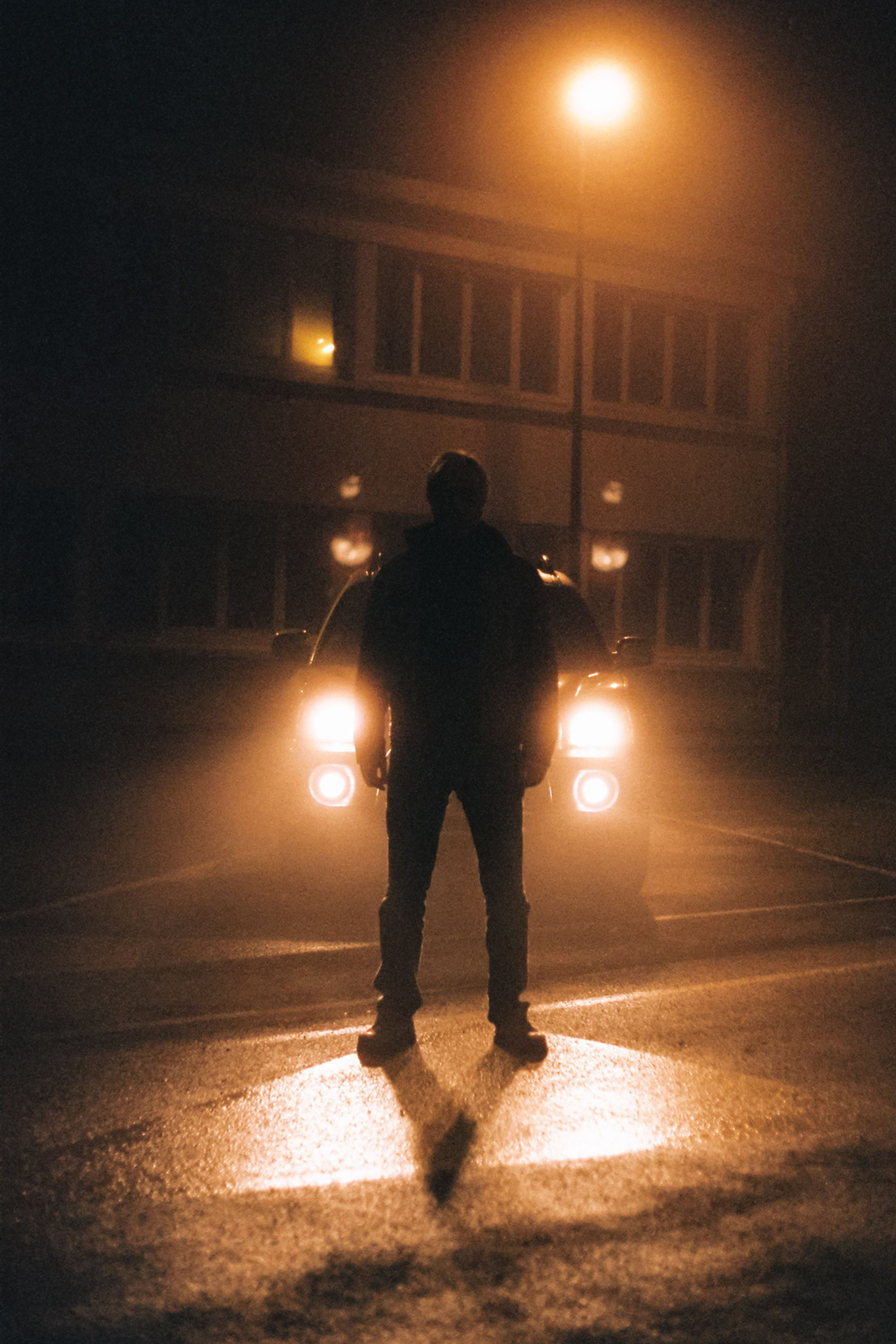 one man only, full length, only men, rear view, illuminated, one person, night, silhouette, adults only, standing, men, road, people, city, adult, cityscape, outdoors