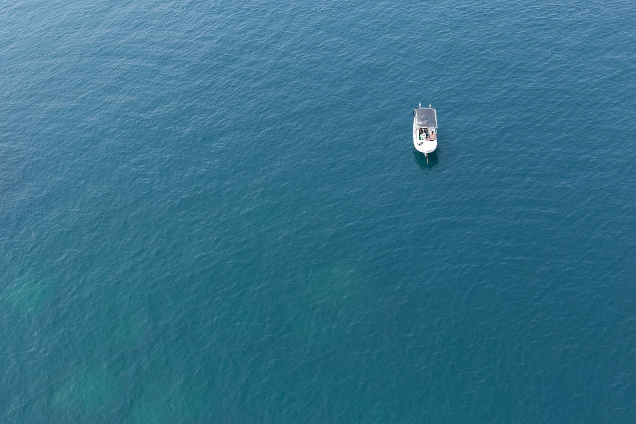 Boat waiting on blue sea until divers return Blue Blue Sea Blue Water Boat Boat Ride Composition Day Deep Sea Float Floating On Water High Angle View Isolated Lanka No People Ocean Outdoors Sea Sri Lanka Transport Wallpaper Water White Boat First Eyeem Photo