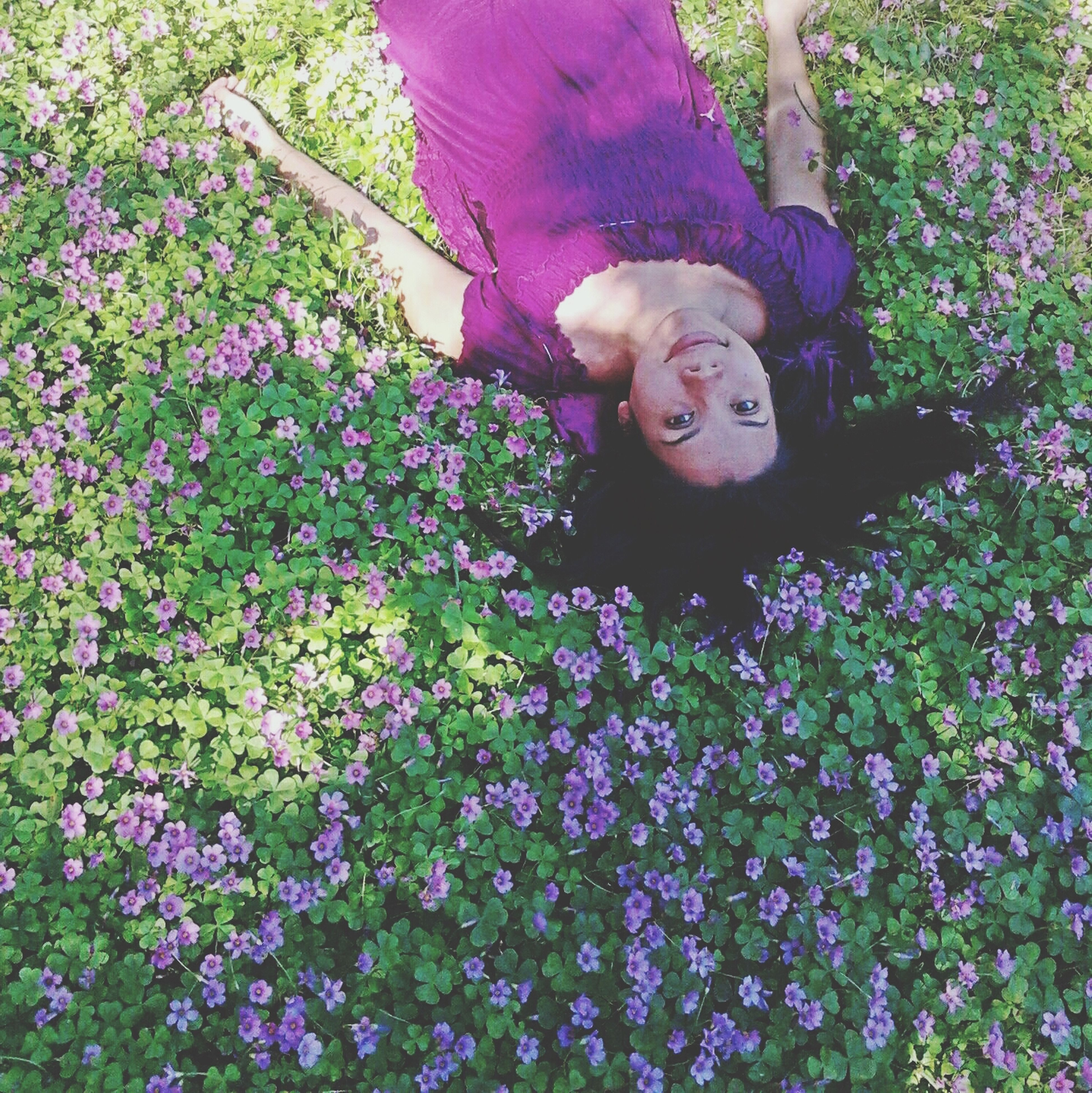 flower, growth, plant, looking at camera, portrait, park - man made space, childhood, nature, pink color, person, day, beauty in nature, tree, freshness, outdoors, front view, field, toy, sitting, fragility