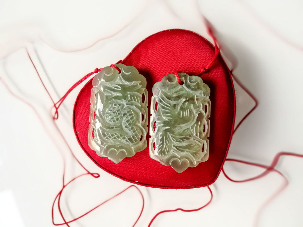 Marriage Charm Red Indoors  Close-up No People White Background Jade Phoenix Dragon Auspicious Marriage  Love Valentine Precious Stone Jade Stone Chinese Symbols Lieblingsteil Symbols Favourite Things Treasure Carved Stones Chinese Dragon Chinese Phoenix Art And Craft