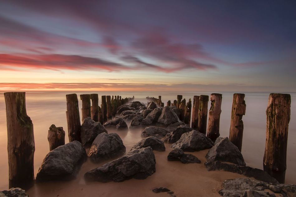 The sands of the time Sunset Rock - Object Beauty In Nature Sea Nature Sky Tranquil Scene Tranquility Cloud - Sky Beach No People Horizon Over Water Outdoors Ocean View Colors Calm Le Penon Les Landes France Atlantic Ocean Finding New Frontiers