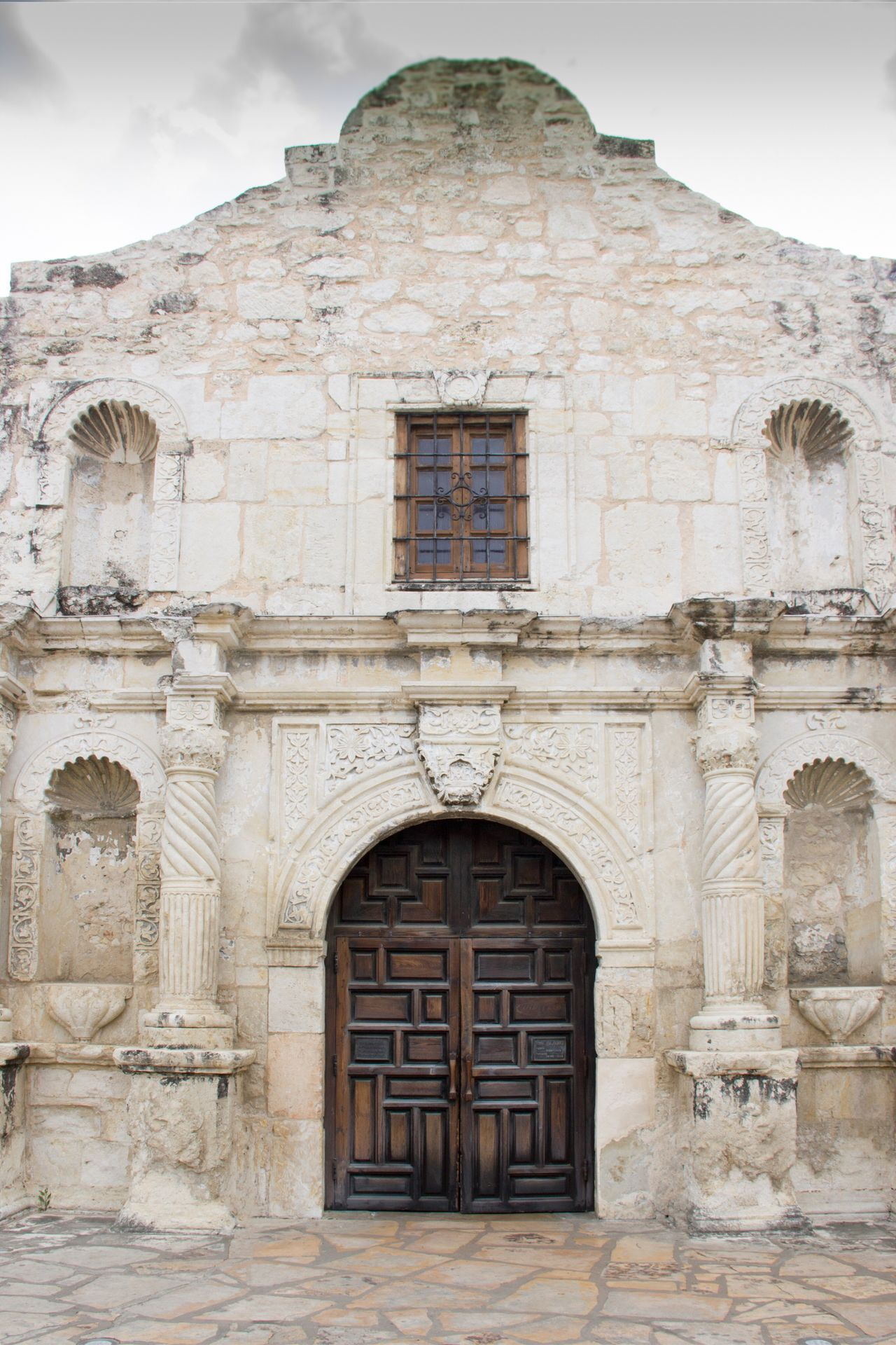 The Architect - 2017 EyeEm Awards Door Stone Material Architecture History Entrance Arch Doorway Ancient Outdoors Travel Destinations No People Building Exterior Built Structure Day Sky Close-up Ladyphotographerofthemonth The Alamo Whitewashed Façade Texas Historical Building Historical Monuments
