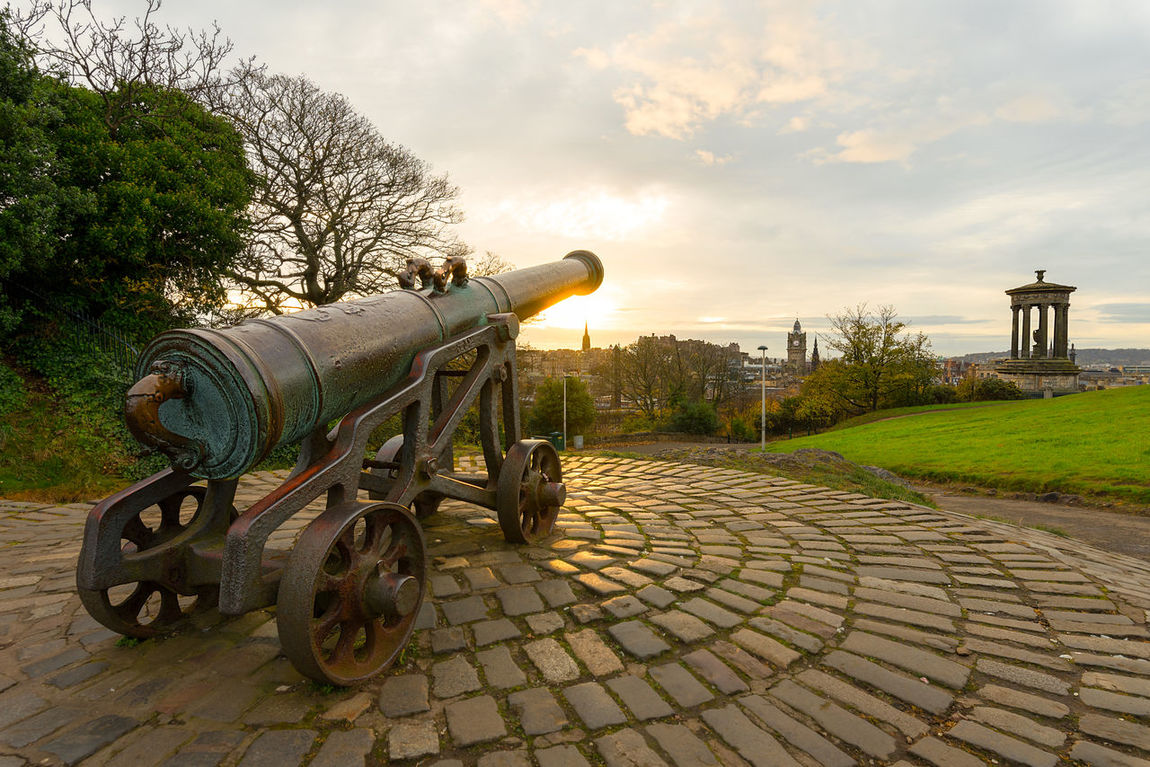 The Portuguese Cannon (Calton Hill Cannon) and the Dugald Stewart Monument over looking the city of Edinburgh from Calton Hill during a autumn sunrise. Calton Hill Castle Rock Cityscape Edinburgh Edinburgh Castle Edinburgh, Scotland Skyline Cannon Canon Day Dugald Stewart Monument Historical History Nature No People Outdoors Portuguese Cannon Sky Sunrise Tree Weapon