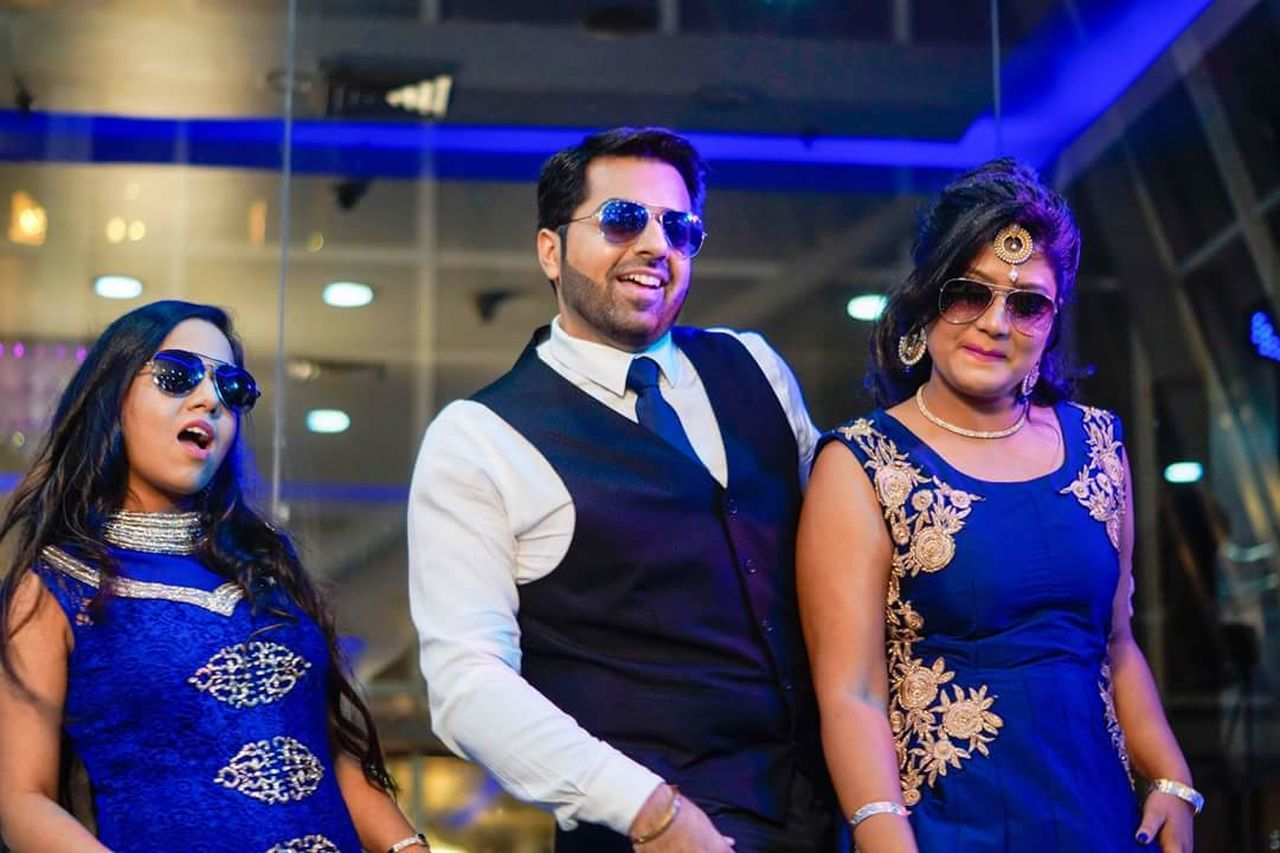 night, sunglasses, young adult, young women, smiling, focus on foreground, blue, portrait, happiness, indoors, togetherness, looking at camera, illuminated, real people, adult, people, adults only