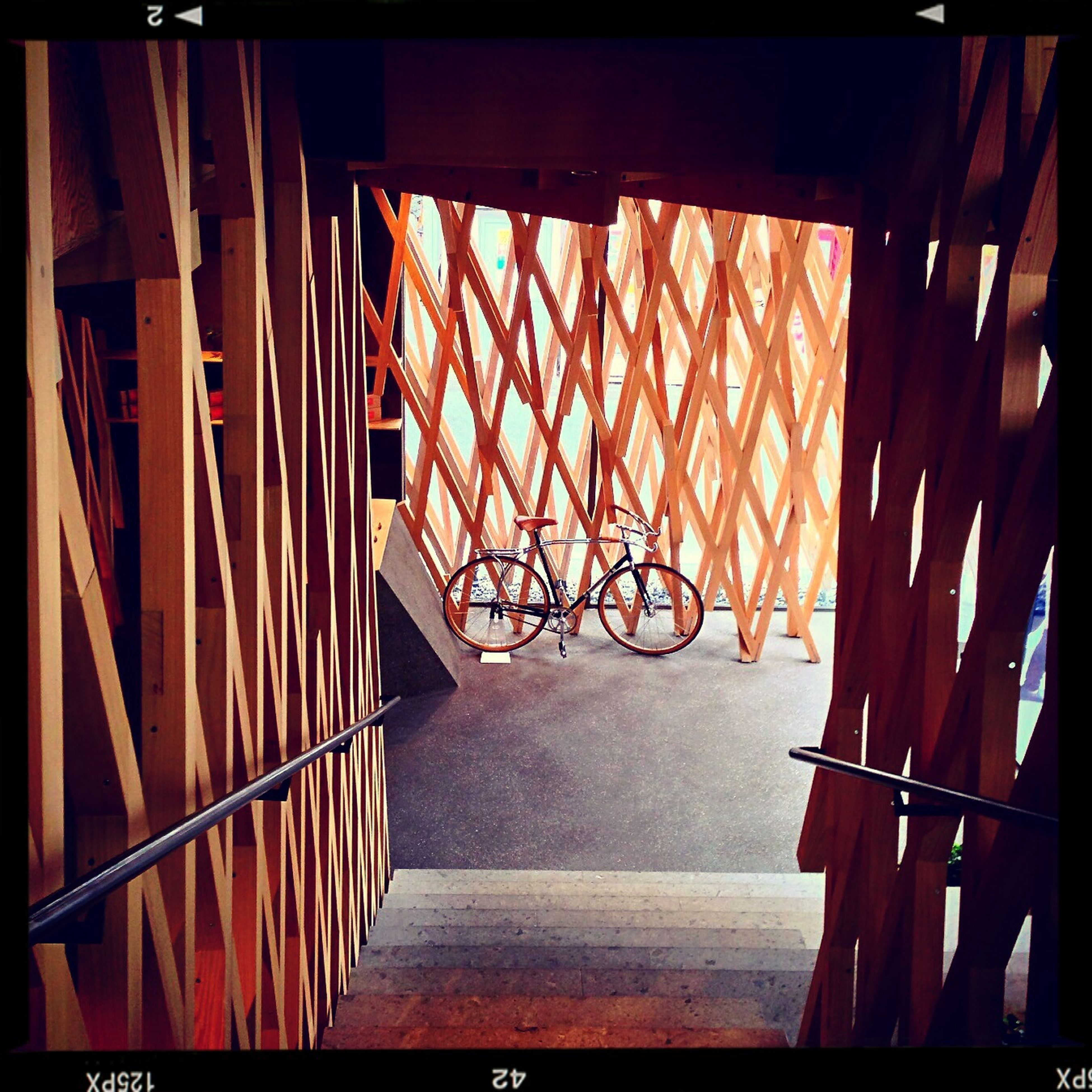 built structure, architecture, railing, sunlight, indoors, metal, wood - material, shadow, steps, protection, safety, no people, auto post production filter, building exterior, fence, metallic, pattern, day, orange color, staircase