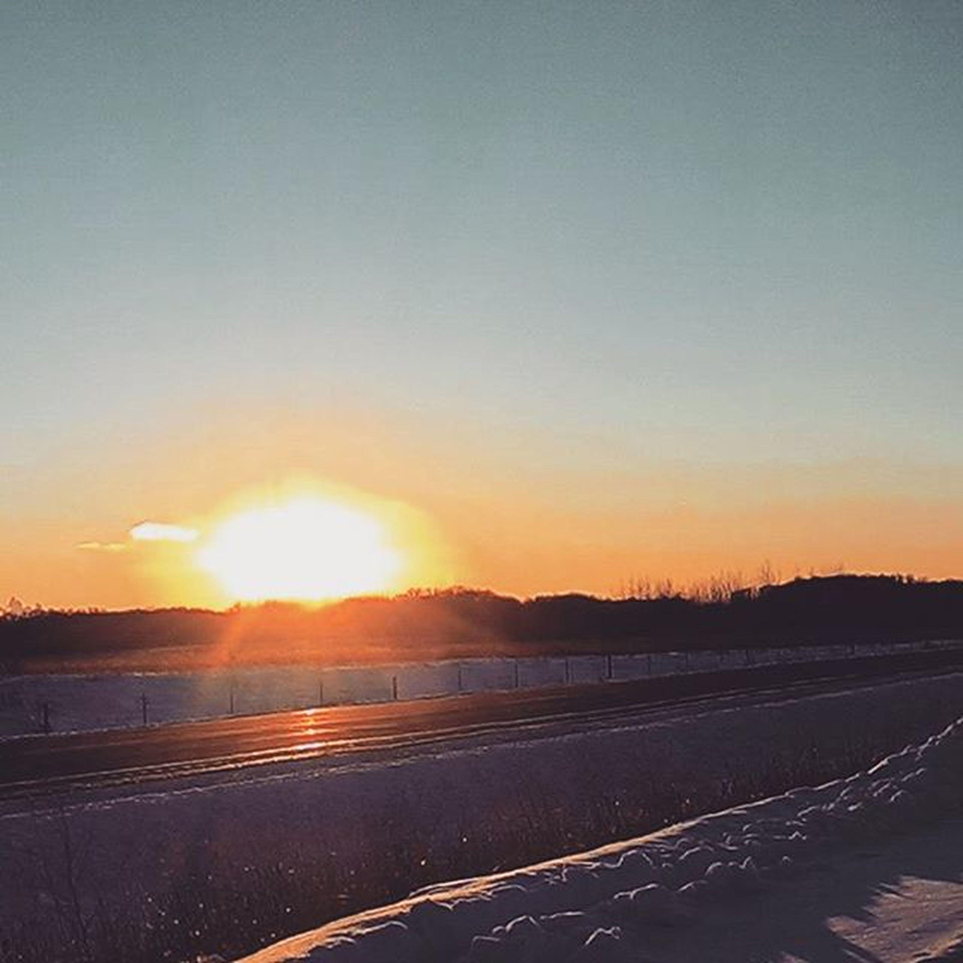 sunset, sun, orange color, tranquility, tranquil scene, scenics, beauty in nature, sunlight, nature, landscape, clear sky, copy space, sunbeam, idyllic, sky, road, transportation, outdoors, no people, field