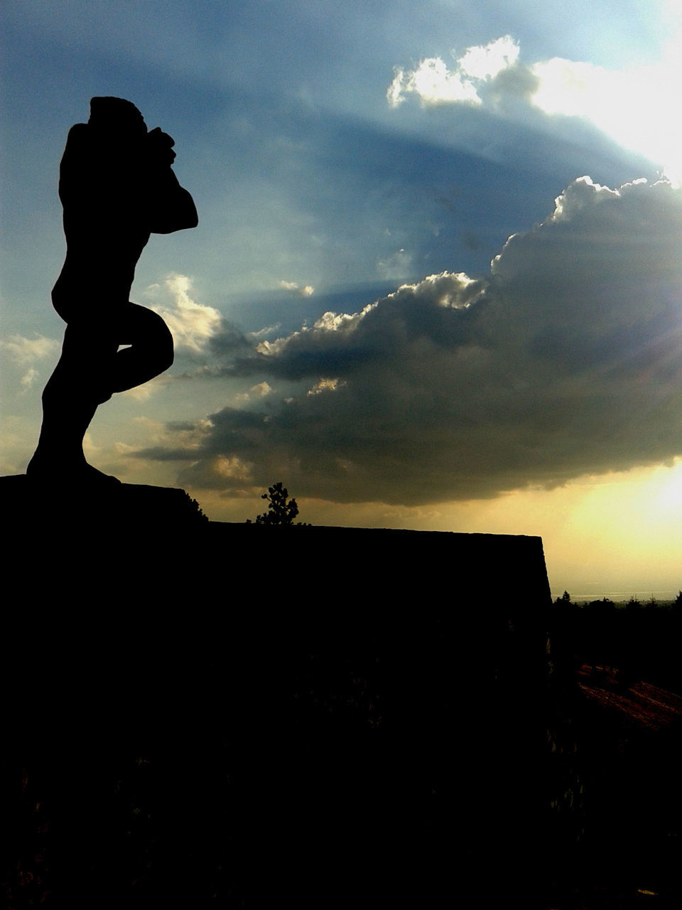 Low Angle View Of Silhouette Sculpture Against Sky During Sunset