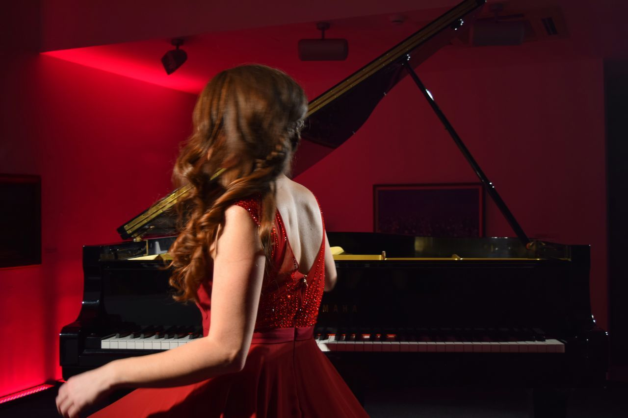 Red One Woman Only Arts Culture And Entertainment Piano Piano Key Piano Keys Concert Photography Concert Piano Moments Red Red Dress Piano Player Evening Gown Motion Art Woman In Motion