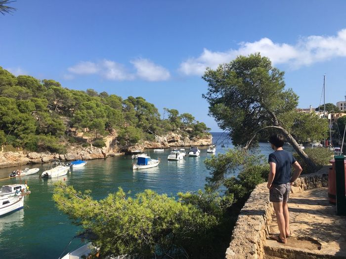 Real People Tree Water Day Standing Full Length One Person Sky Leisure Activity Outdoors Casual Clothing Childhood Nature Boys Lifestyles Nautical Vessel Lake Beauty In Nature Growth Architecture Window No Filter, No Edit, Just Photography Mallorca Holiday Happiness