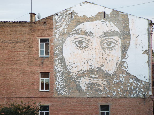 This is an artwork by Vhils, he came to Kyiv to create a mural of activist Serhiy Nihoyan on the wall of a downtown building near Mykhailivska Square. He was one of the first victims of the EuroMaiden Revolution. Art Brick Wall Building Building Exterior Built Structure Close-up Creativity Euromaidan Kiev Kiev Ukraine Mykhailivska Square Outdoors Street Art Street Art/Graffiti The Photojournalist - 2016 EyeEm Awards The Street Photographer - 2016 EyeEm Awards Ukraine Vhils
