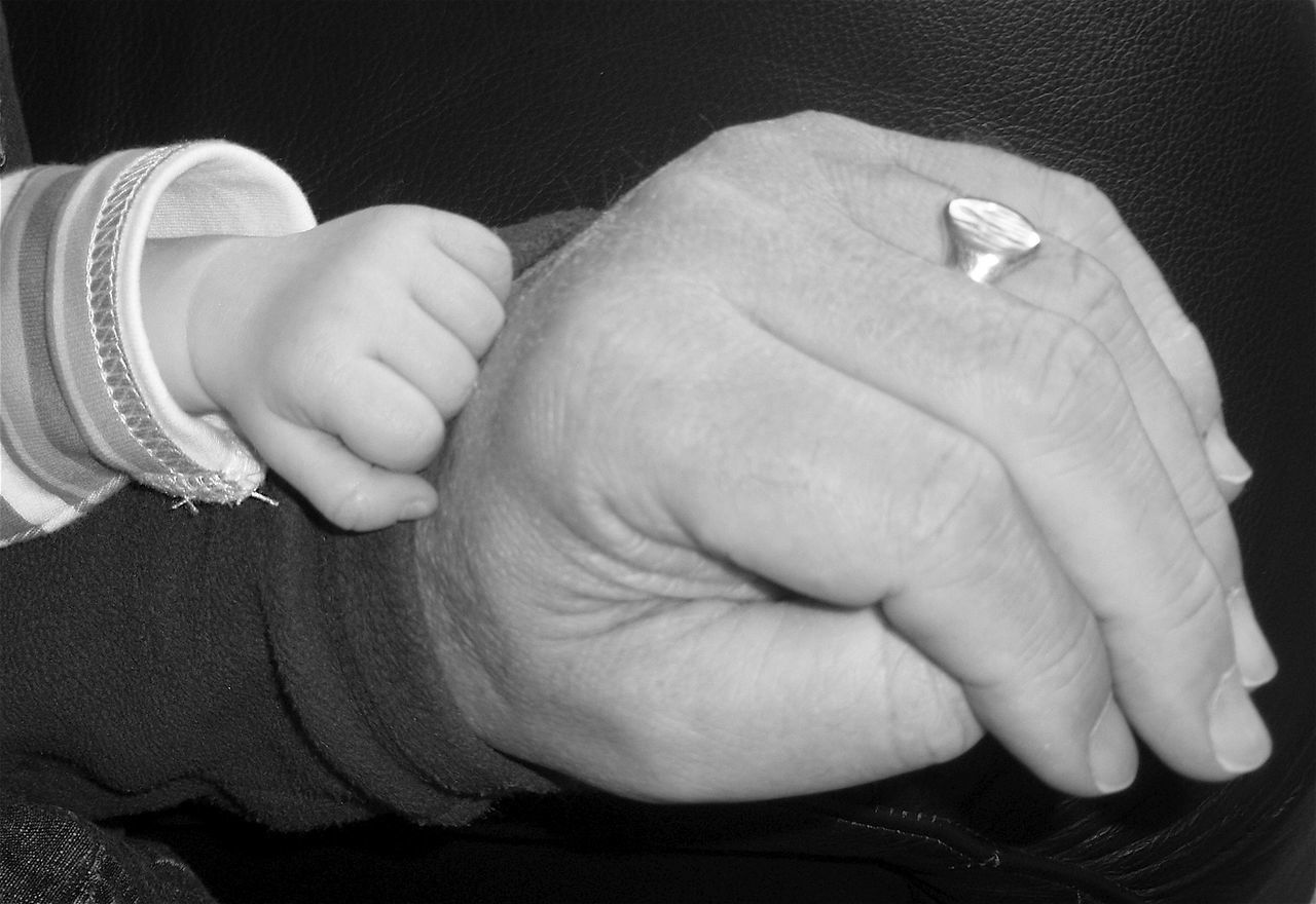 Baby And Grandfather Black Background Casual Clothing Close-up Cropped Focus On Foreground Fragility Human Finger Leisure Activity Lifestyles Part Of Person Unrecognizable Person