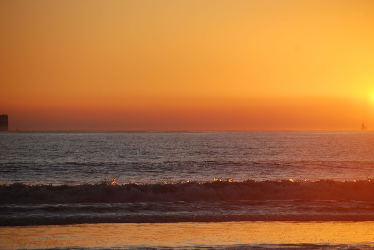 Beach Beauty In Nature Day Horizon Over Water Nature No People Orange Color Outdoors Scenics Sea Sky Sun Sunrise Sunset Tranquil Scene Tranquility Water Waves Waves Reflecting Sun