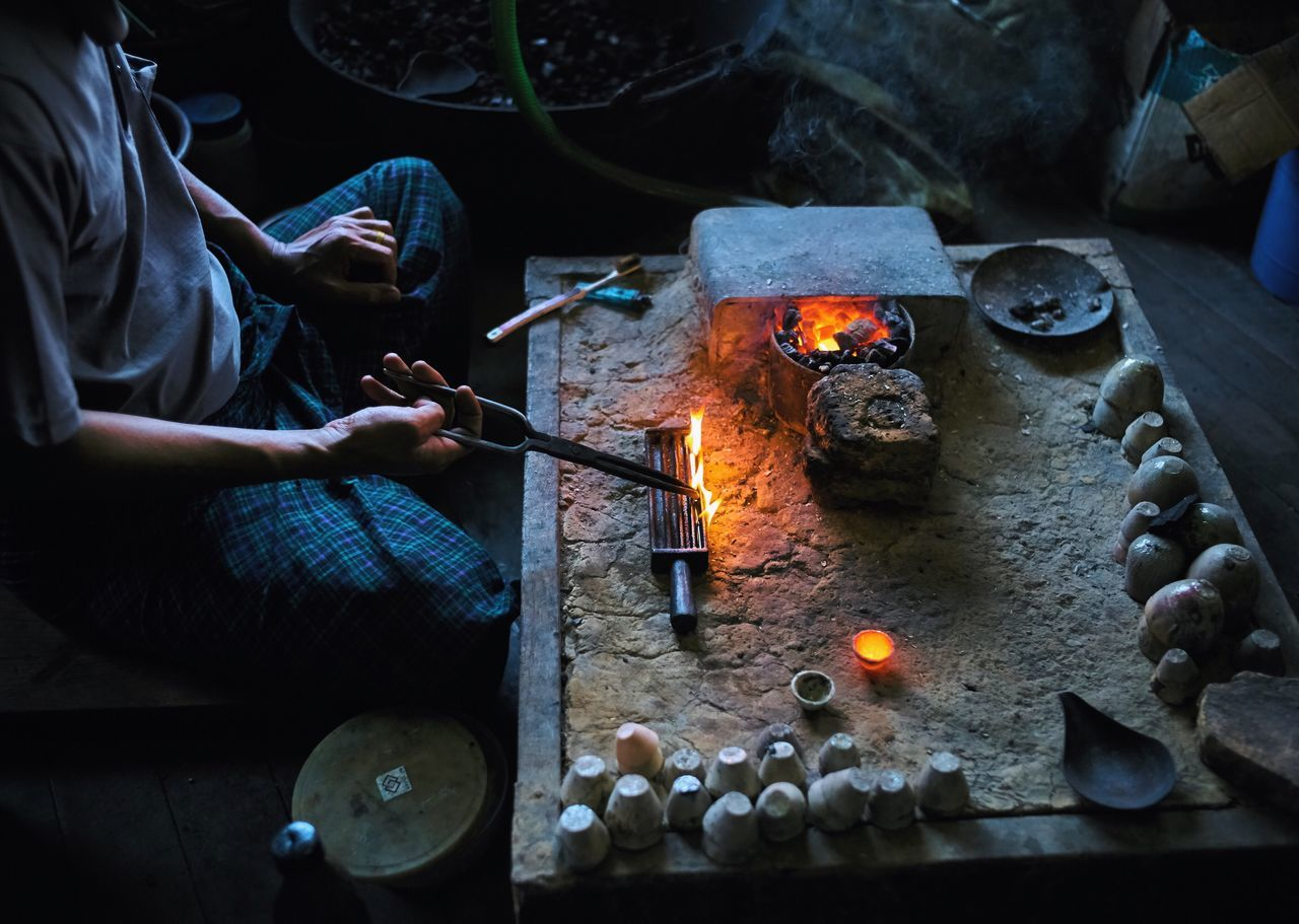 Flame Real People Heat - Temperature Burning Preparation  Human Body Part Indoors  Men Human Hand Women Food Night People Silver  Myanmar Inle Lake Artisan BYOPaper!