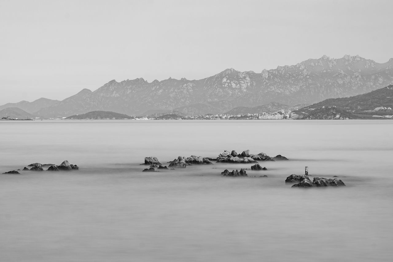 calm sea Black And White Day Horizon Over Water Landscape Monochrome Mountain No People Outdoors Peaceful Reef Rock Sea Sky Water