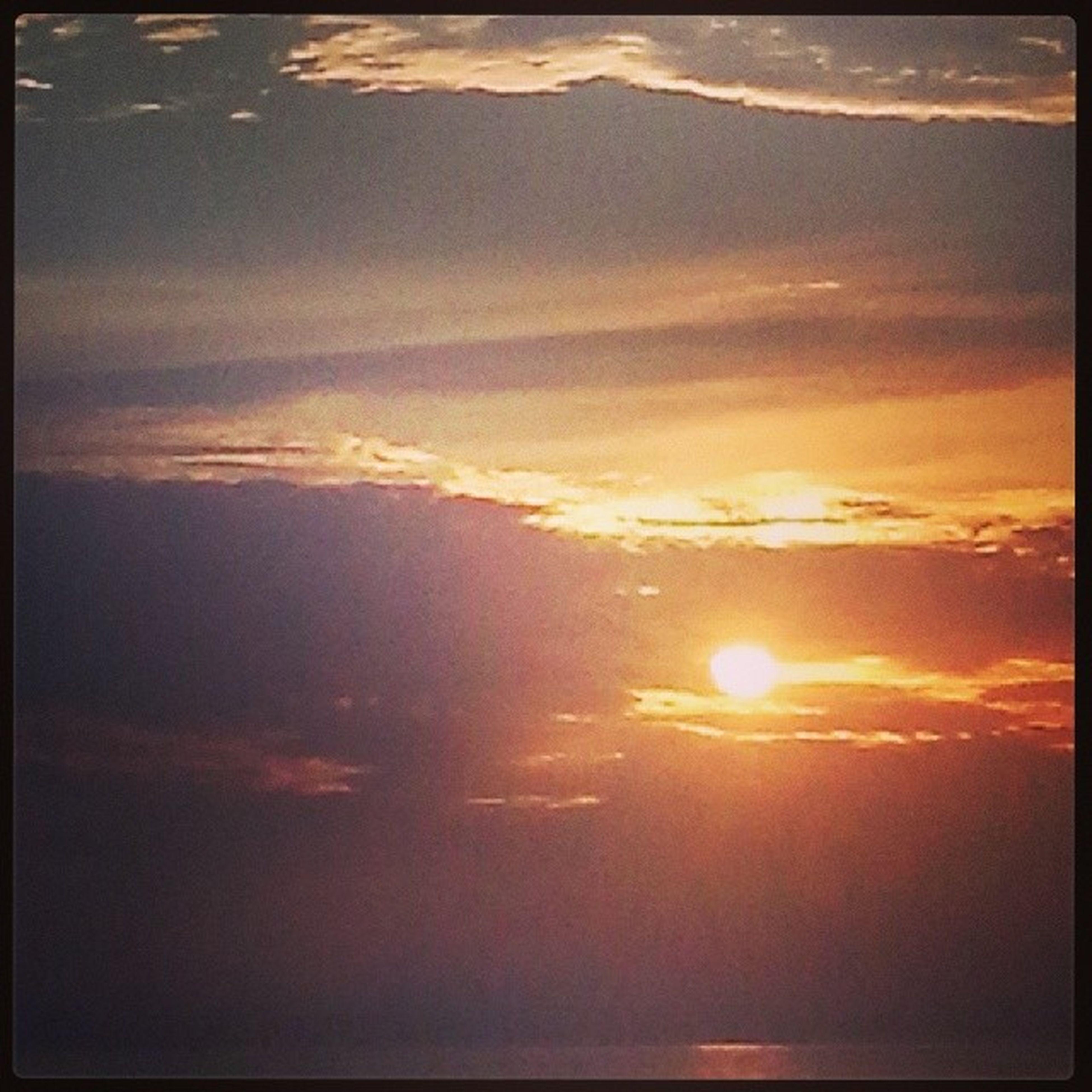 sunset, transfer print, sun, scenics, beauty in nature, orange color, auto post production filter, tranquility, sky, tranquil scene, nature, idyllic, cloud - sky, sunlight, backgrounds, sunbeam, outdoors, no people, majestic, cloud