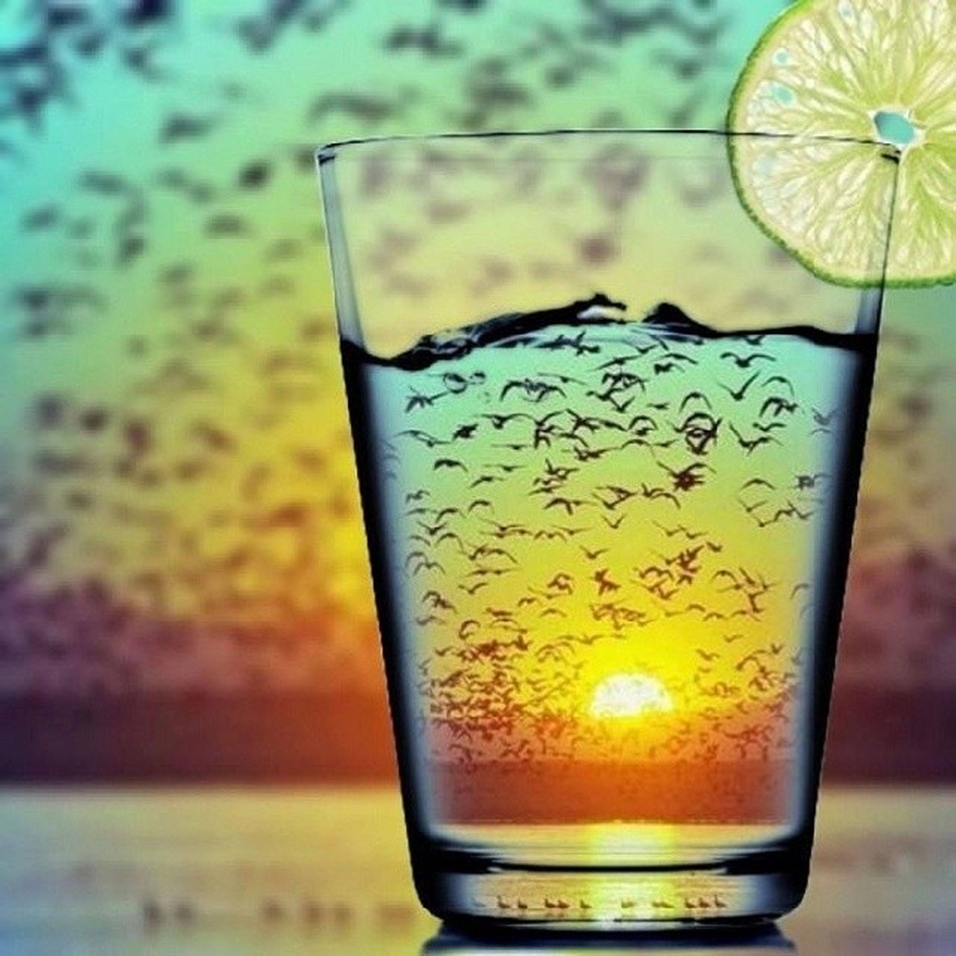close-up, drink, glass - material, focus on foreground, transparent, refreshment, freshness, sunset, food and drink, drinking glass, indoors, glass, still life, orange color, yellow, alcohol, table, no people, fragility, single object