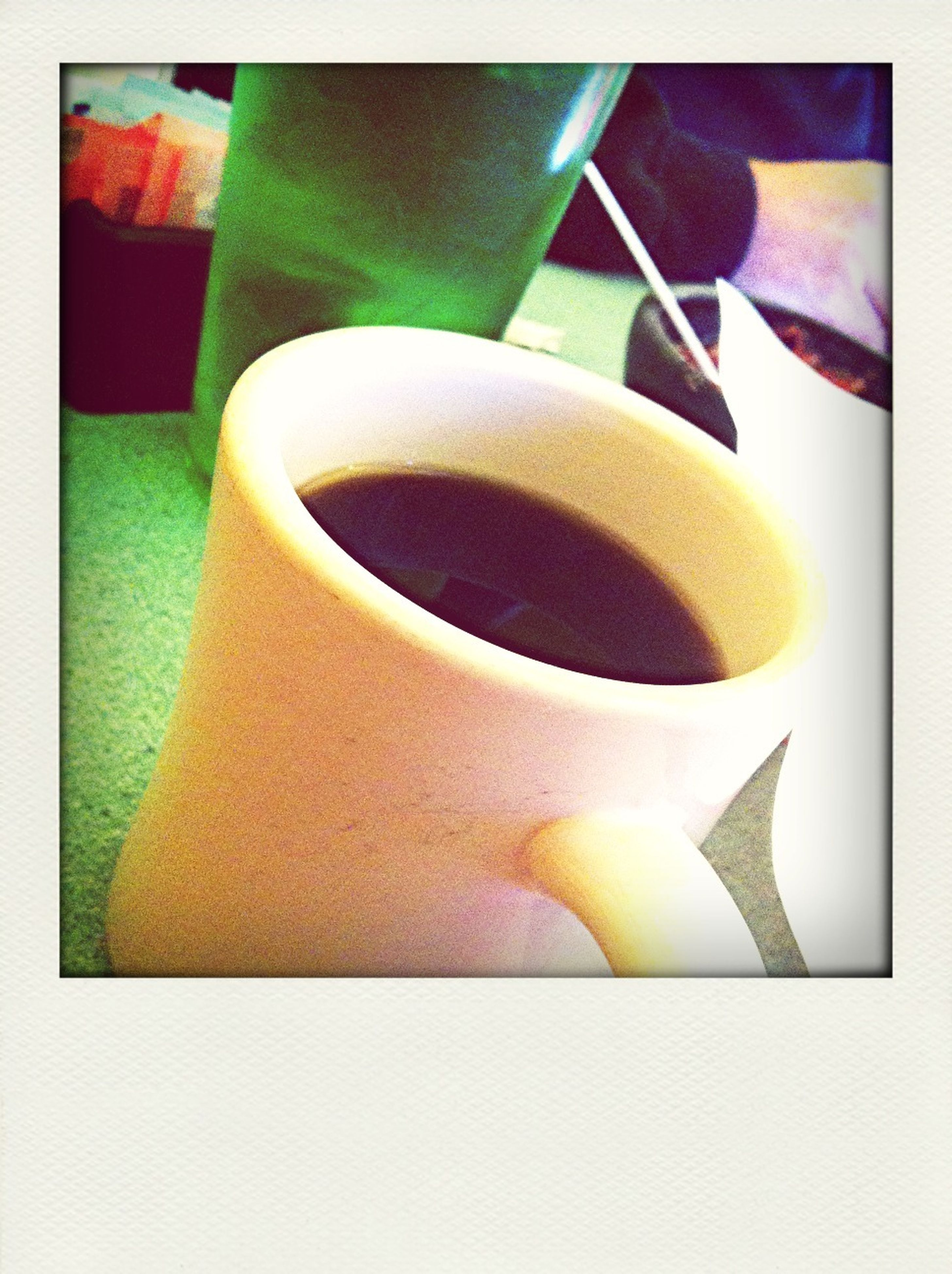transfer print, auto post production filter, indoors, still life, close-up, table, high angle view, no people, frame, freshness, drink, food and drink, coffee cup, yellow, refreshment, day, single object, multi colored, book, paper