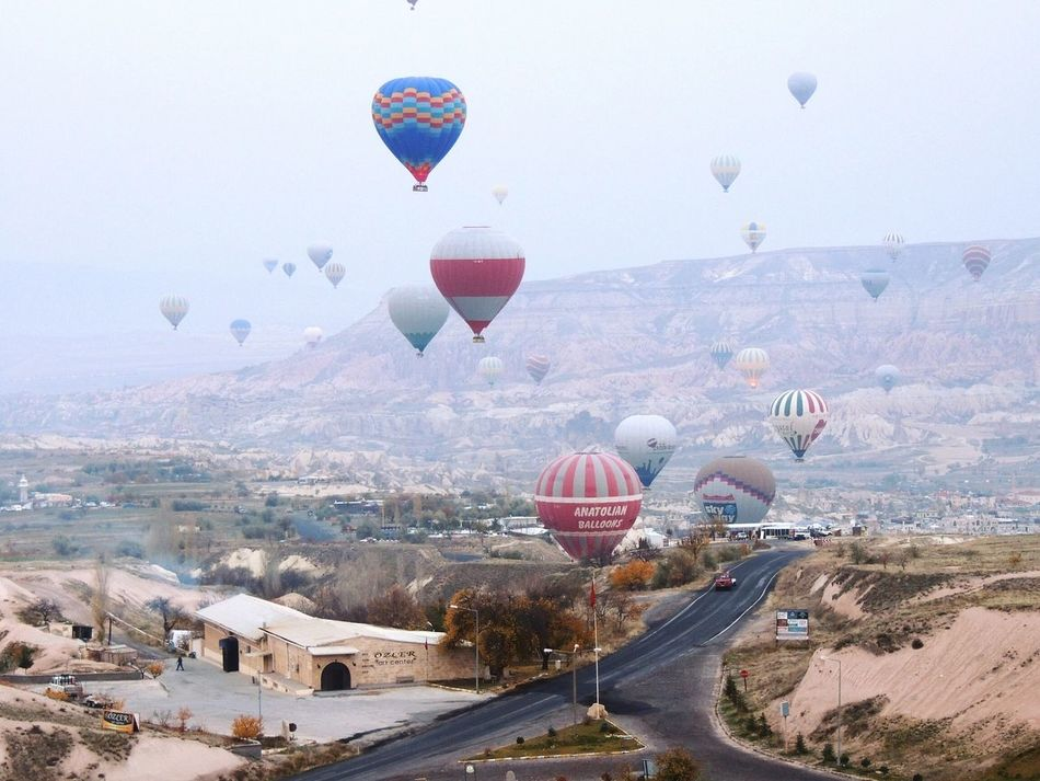 Hot Air Balloon Adventure Outdoors Landscape Mountain Cappadocia/Turkey Cappadocia Hot Air Ballons Cappadociasunrise Cityscapes Skyline View Travel Destinations Travel Photography Travelingtheworld  Traveldiaries Sunrise - Dawn Sunrise N Sunsets Worldwide  Sunrise Photography Colors Of Autumn