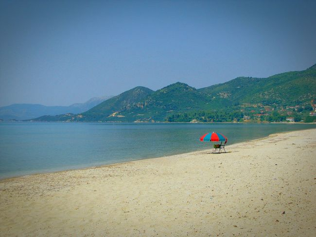 The Essence Of Summer The Great Outdoors - 2016 EyeEm Awards Beach Beach Photography Life Is A Beach Umbrella Lonely Umbrella Shades Of Blue Sandy Beach Minimalism Minimalobsession Minimal Lonely Loneliness Summer Memories 🌄 Blue Sea Blues Crystal Clear Waters Chair And Umbrella Mountains Mountains And Sea