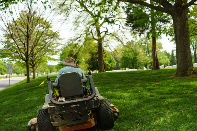 Arlington National Cemetery Casual Clothing Field Grass Graveyard Graveyard Beauty Green Color Growth Lawn Lawnmower Leisure Activity Lifestyles Military Mower Paris Park Park - Man Made Space Relaxation Sitting Soldiers Spring Tree Up Close Street Photography Washington, D. C. Worker