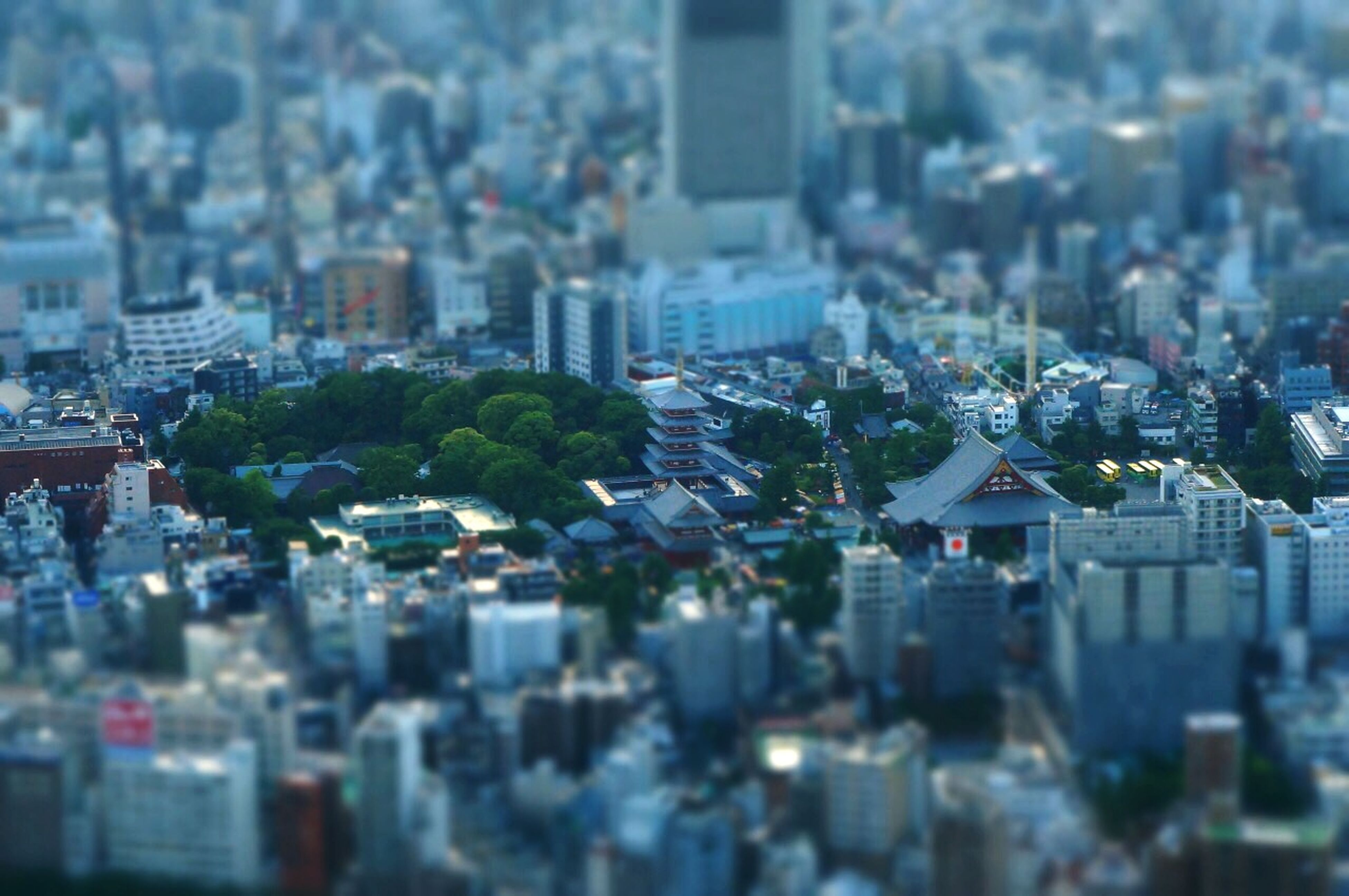 building exterior, architecture, cityscape, city, built structure, crowded, residential district, high angle view, residential building, residential structure, selective focus, city life, focus on foreground, water, aerial view, skyscraper, no people, outdoors, day, tower